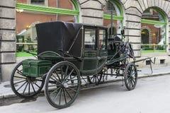 Carriage on the street. Stock Photos
