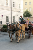 Carriage in the streets of Salzburg Stock Photos