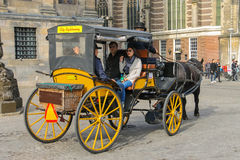 Carriage with for tourists on Dam Square in Amsterdam Royalty Free Stock Images