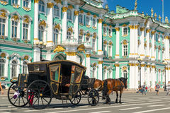 Carriage for tourists in front of the Winter Palace in Saint Pet Stock Photo