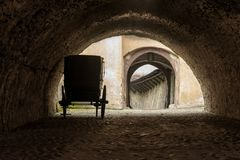 Carriage waiting for its horses. In tunnel royalty free stock photo