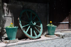 Carriage wheel and flower pots Stock Images