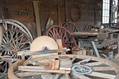 Carriage wheel shop. A view of an antique workshop where vintage Victorian era, horse-drawn carriage wheels were built or repaired.  A person skilled in this Royalty Free Stock Photo