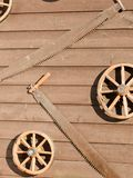 Carriage wheels and saws Royalty Free Stock Photo