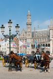 Carriages with cabbies in Bruges Stock Image