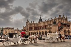 Carriages on Krakow market square. Royalty Free Stock Photography
