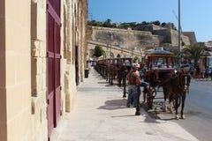 Carriages queue on Valletta harbor street Stock Photos