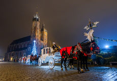 Carriages for riding tourists on the background of Mariacki cathedral Stock Images