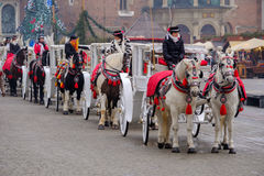 Carriages for riding tourists on the background of Mariacki cathedral Royalty Free Stock Photography