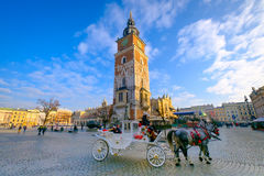 Carriages for riding tourists on the background of town hall Stock Photography