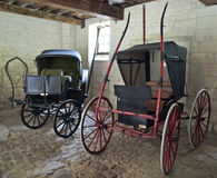 Carriages in shed. In old castle Stock Images