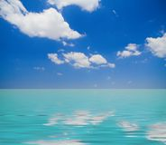 Carribean horizon. Turquoise sea under a breathtaking blue sky with fluffy clouds Stock Photography