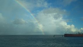 Tanker and Carribean Rainbow at sea. No filters. royalty free stock photos