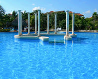 Carribean resort pool. Carribean resort with pool and architectural decor isle Stock Photos