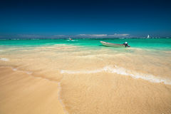 Carribean sea and boat on the shore, beautiful panoramic view Stock Photos