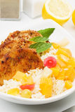 Carribean style pork loin chops. With rice and tropical fruit Stock Image