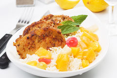 Carribean style pork loin chops. Carribean style spicy pork loin chops with tropical fruit and rice Stock Images