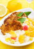 Carribean style pork loin chops. Carribean style spicy pork meat with tropical fruit and cooked rice Stock Photo