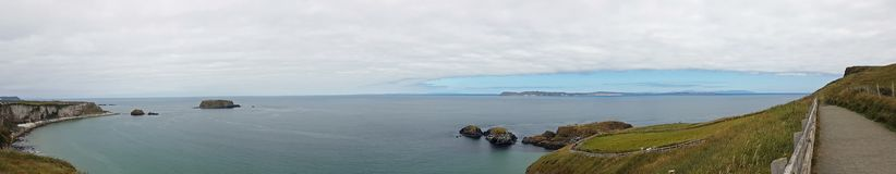 Carrick a Rede Island. Carrick-a-Rede is an island in Northern Ireland off the coast of County Antrim between Ballycastle and Ballintoy. The island is connected stock photography