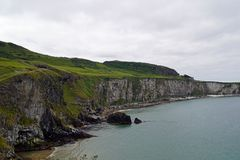 Carrick a Rede Island. Carrick-a-Rede is an island in Northern Ireland off the coast of County Antrim between Ballycastle and Ballintoy. The island is connected royalty free stock photo