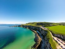 Carrick a Rede Rope Bridge in Ballintoy Northern Ireland. Aerial view on Cliffs and turquoise Atlantic Ocean water. Carrick a Rede Rope Bridge in Ballintoy stock photo