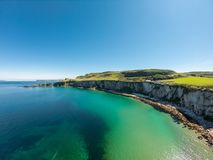 Carrick a Rede Rope Bridge in Ballintoy Northern Ireland. Aerial view on Cliffs and turquoise Atlantic Ocean water. Carrick a Rede Rope Bridge in Ballintoy royalty free stock photography