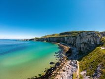 Carrick a Rede Rope Bridge in Ballintoy Northern Ireland. Aerial view on Cliffs and turquoise Atlantic Ocean water. Carrick a Rede Rope Bridge in Ballintoy stock photography