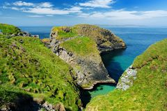 Carrick-a-Rede Rope Bridge, famous rope bridge near Ballintoy in County Antrim, linking the mainland to the tiny island of Carrick royalty free stock photography