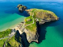 Carrick-a-Rede Rope Bridge, famous rope bridge near Ballintoy in County Antrim, linking the mainland to the tiny island of Carrick stock images