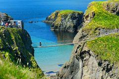 Carrick-a-Rede Rope Bridge, famous rope bridge near Ballintoy in County Antrim, linking the mainland to the tiny island of Carrick. Arede. One of the most iconic stock photos