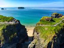 Carrick-a-Rede Rope Bridge, famous rope bridge near Ballintoy in County Antrim, linking the mainland to the tiny island of Carrick stock photo