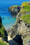 Carrick-a-Rede Rope Bridge, famous rope bridge near Ballintoy in County Antrim, linking the mainland to the tiny island of Carrick stock photos