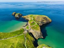 Carrick-a-Rede Rope Bridge, famous rope bridge near Ballintoy in County Antrim, linking the mainland to the tiny island of Carrick stock image