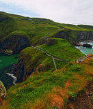 Carrick-a-Rede tiny Irish Coastal Island with suspension bridge and walking path Royalty Free Stock Photo