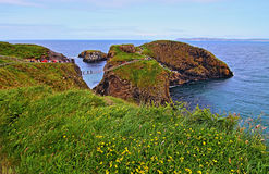Carrick-a-Rede tiny Irish Coastal Island with suspension bridge and walking path Royalty Free Stock Image