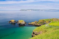 Carrick-a-Rede and two smaller islands in County Antrim, Northern Ireland. Showing the emerald coloured sea with the islands in the middle ground and the royalty free stock images