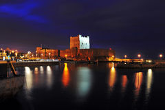 Carrickfergus Castle. Carrickfefgus, Co.Antrim, Northern Ireland at night stock images
