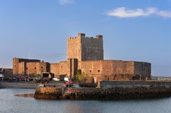 Carrickfergus Castle. Medieval Norman Castle in Carrickfergus, Northern Ireland, in sunset light Royalty Free Stock Photos
