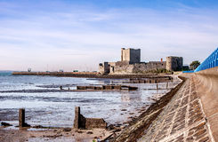 Carrickfergus Castle, Northern Ireland. Medieval Norman Castle in Carrickfergus near Belfast, Northern Ireland, and Belfast Lough during a low tide Stock Photos