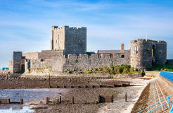 Carrickfergus Castle, Northern Ireland. Medieval Norman Castle in Carrickfergus near Belfast, Northern Ireland, during a low tide Royalty Free Stock Photography