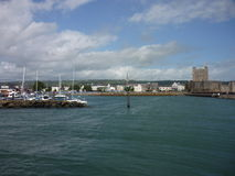Carrickfergus, Northern Ireland. View of Carrickfergus town with the famous castle on the right royalty free stock photo