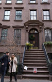 Carrie Bradshaw appt. New York, USA. Dec 28, 2016: Private NYC apartment according to film `Sex in the city`, Carrie Bradshaw lived in, surrounded with fans of Royalty Free Stock Photo