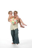 Carried away. Older brother carrying his younger sister Royalty Free Stock Photo