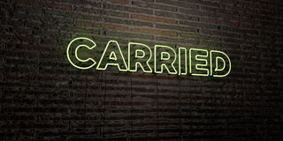 CARRIED -Realistic Neon Sign on Brick Wall background - 3D rendered royalty free stock image. Can be used for online banner ads and direct mailers Stock Photo