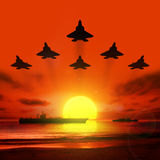 Carrier battle groups at sea. Carrier battle groups at sea against the setting sun Stock Photography