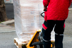 Carrier moving boxes using a fork lift Royalty Free Stock Images