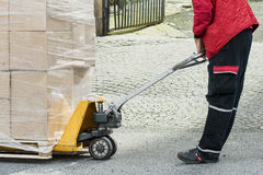 Carrier moving boxes using a fork lift Stock Photo