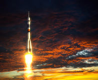 Carrier Rocket On A Background Of Red Clouds. 3D Scene Stock Images
