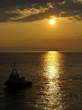 Carrier ship at sunset in the sea Royalty Free Stock Images