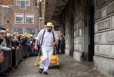 Carriers walking with many cheeses in the famous Dutch cheese market in Alkmaar, The Netherlands. royalty free stock photography